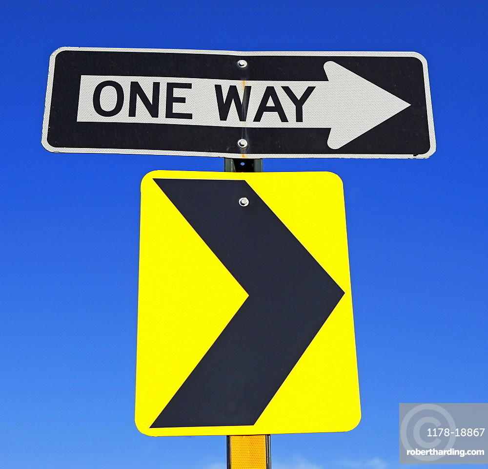 One Way and arrow street signs