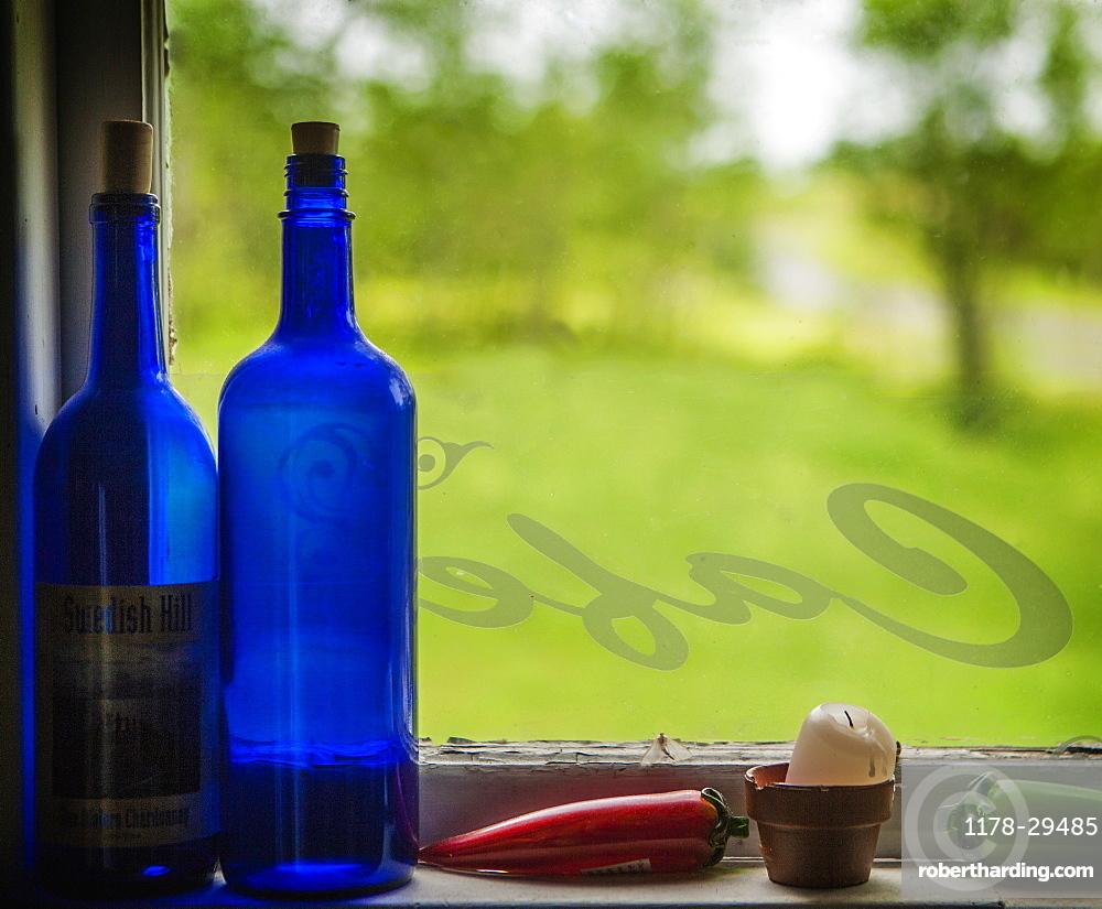 United Kingdom, England, Blue bottles on window sill