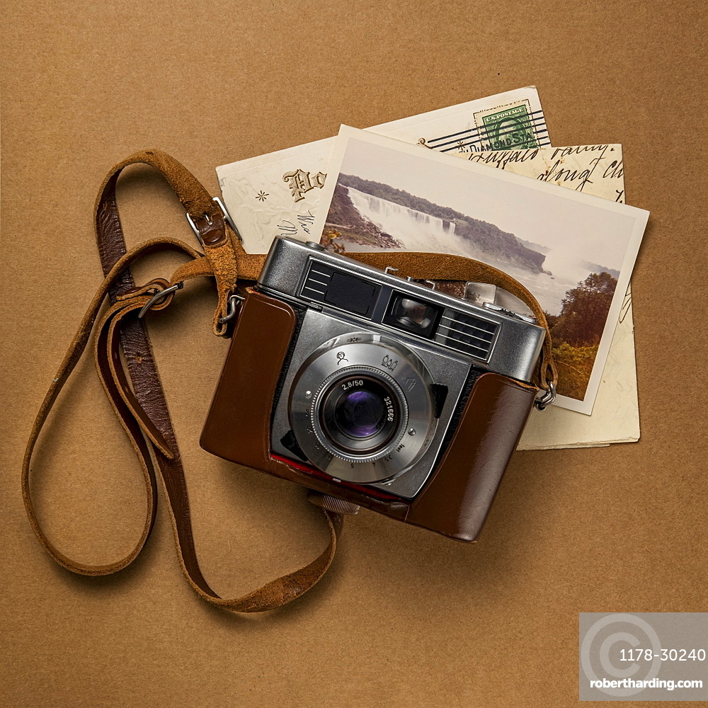 Retro amateur 35mm camera with postcards and letters