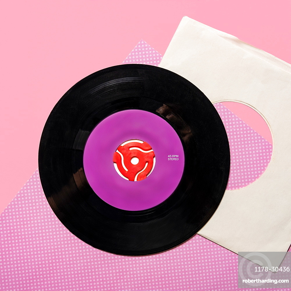Vintage record on pink and purple background