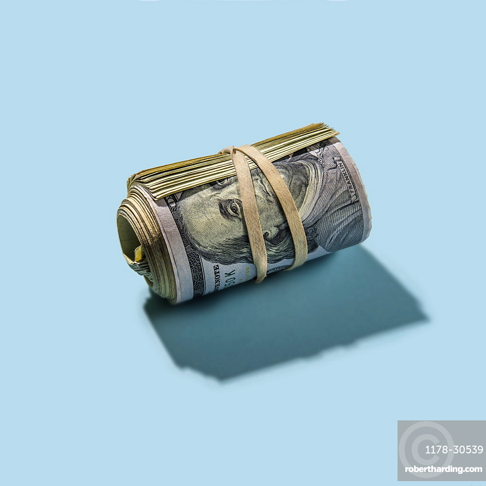 Roll of US dollar bills