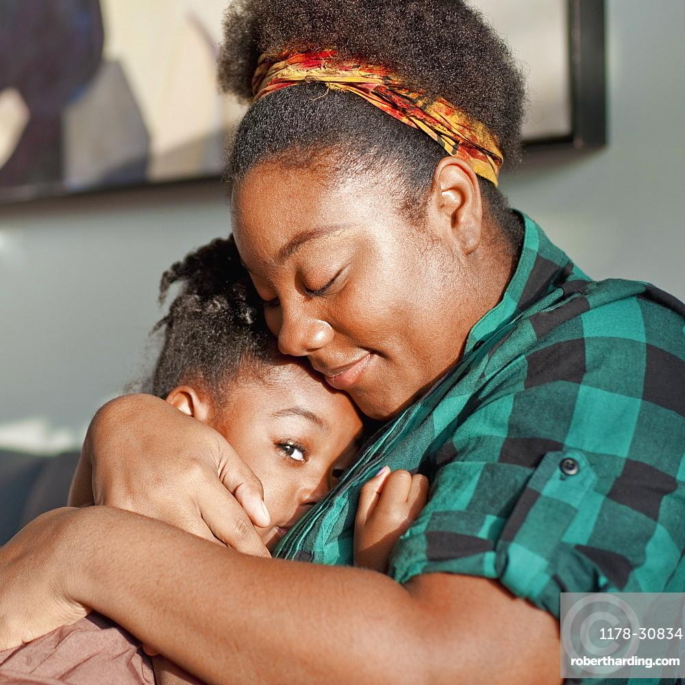 African American mother comforting daughter