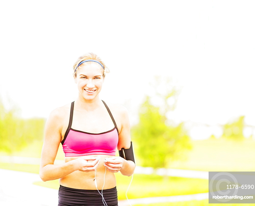 Portrait of young woman in sports clothing standing in park, Jupiter, Florida