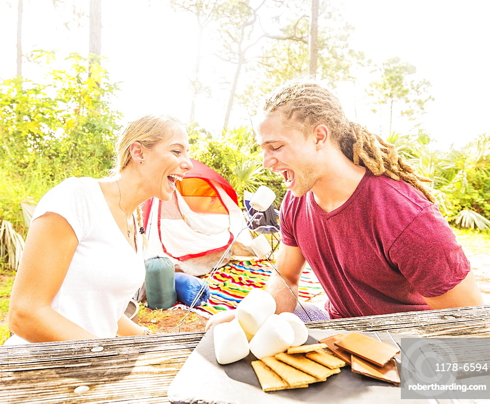 Couple sitting at table with snacks, Tequesta, Florida