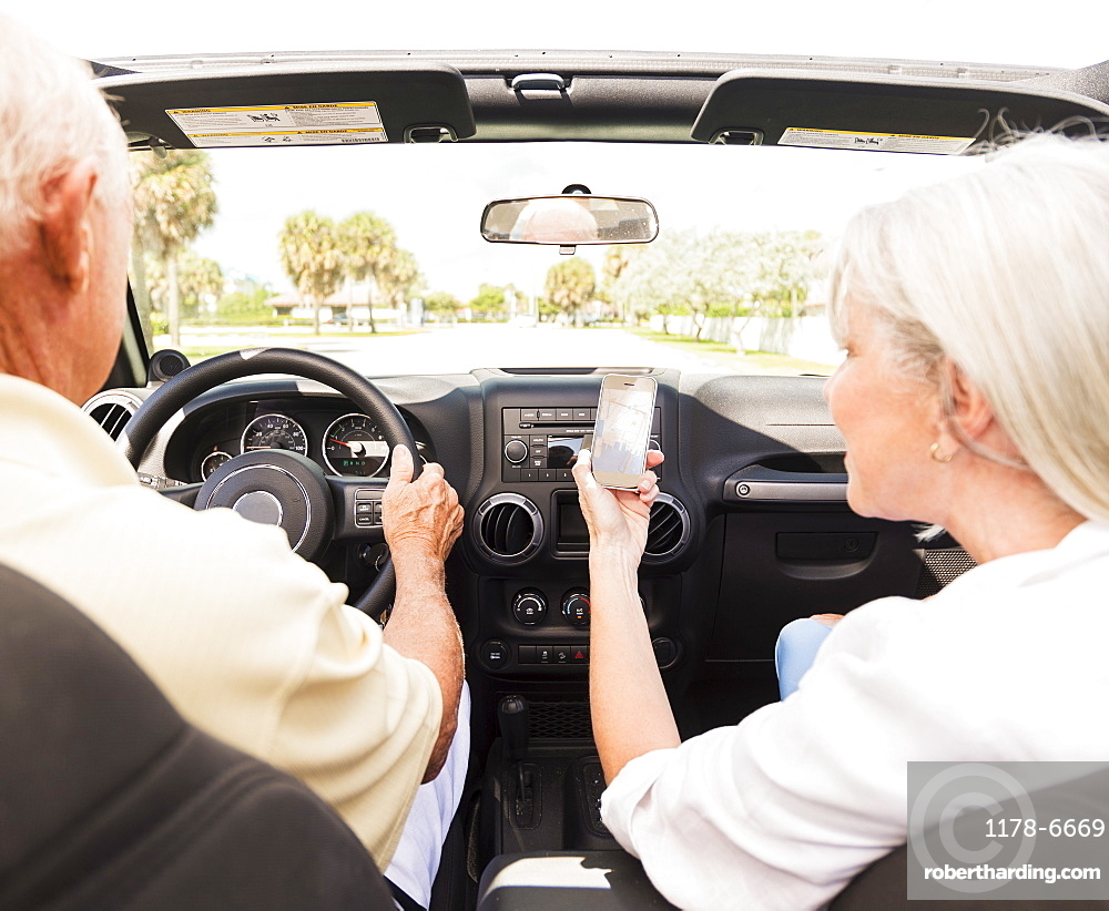 Senior couple in convertible car, Jupiter, Florida