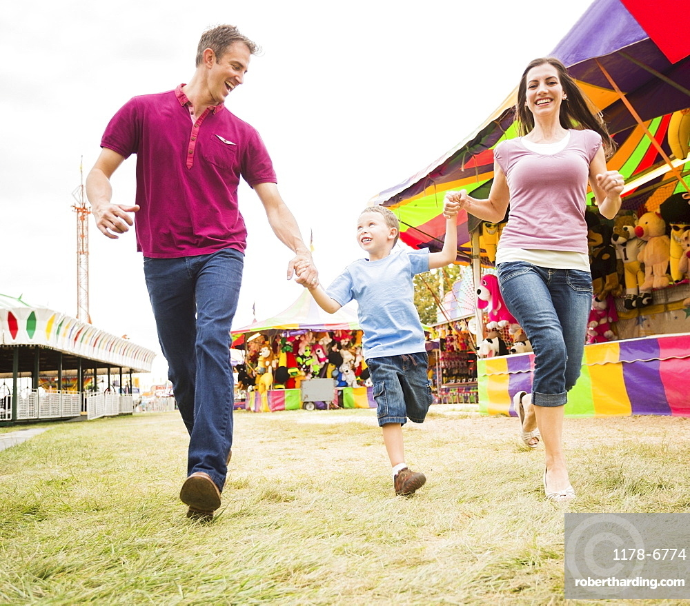 Happy Family and son (4-5) in amusement park, USA, Utah, Salt Lake City