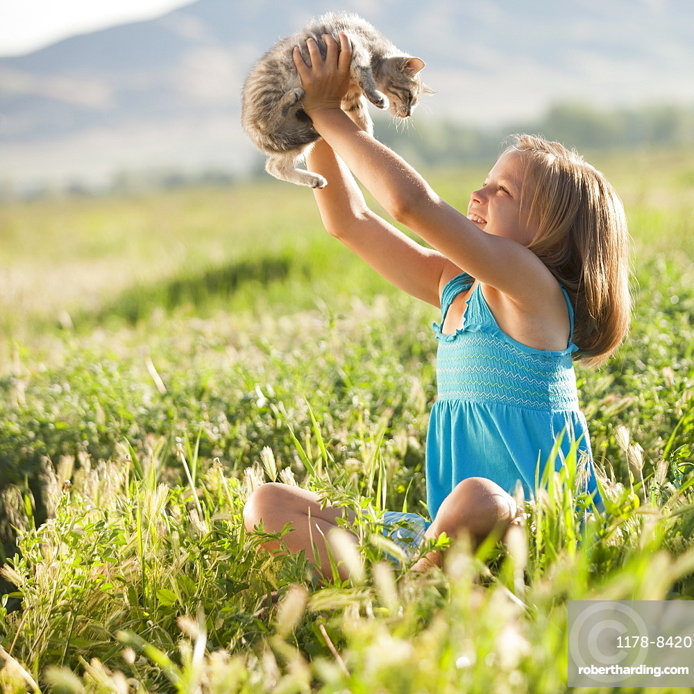 Young girl holding a kitten