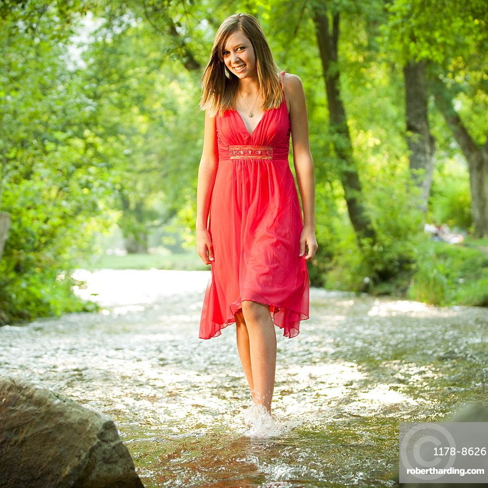 Portrait of woman walking in river