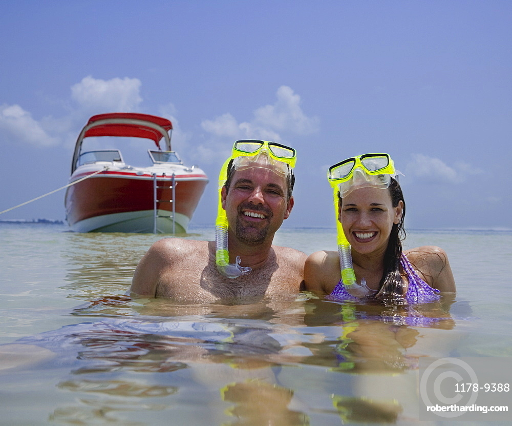 Couple with snorkeling gear in water, Florida, United States