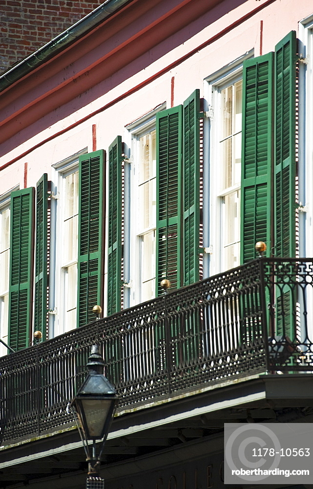 Balcony and windows with green shutters
