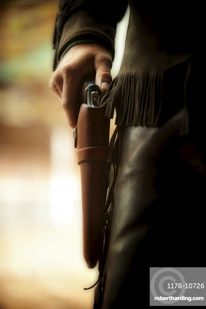 Cowboy with gun in holster