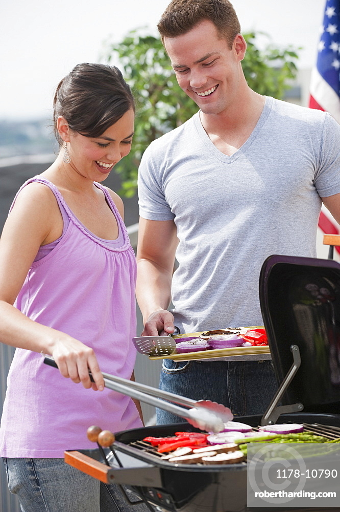 Couple barbequing