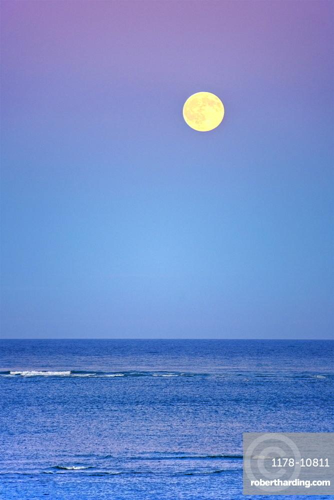Moonrise over ocean