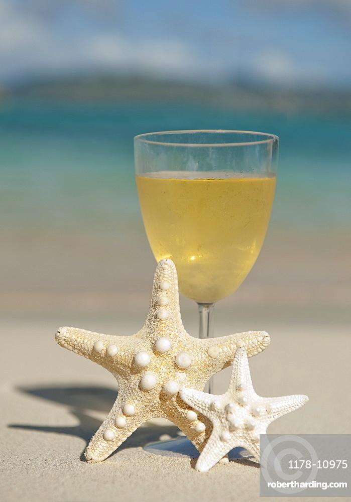 Glass of wine and sea stars