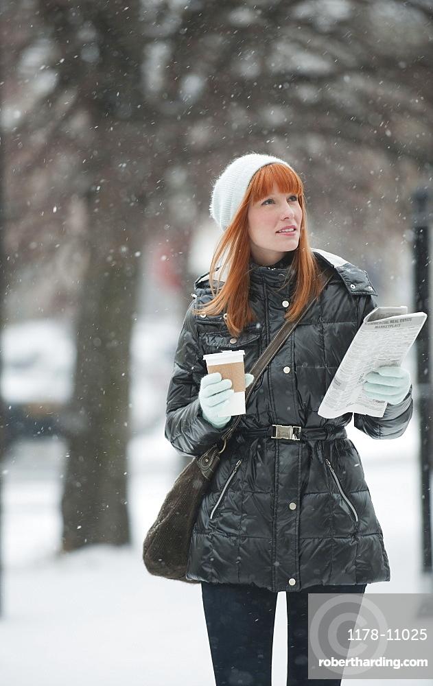 Woman walking in snow