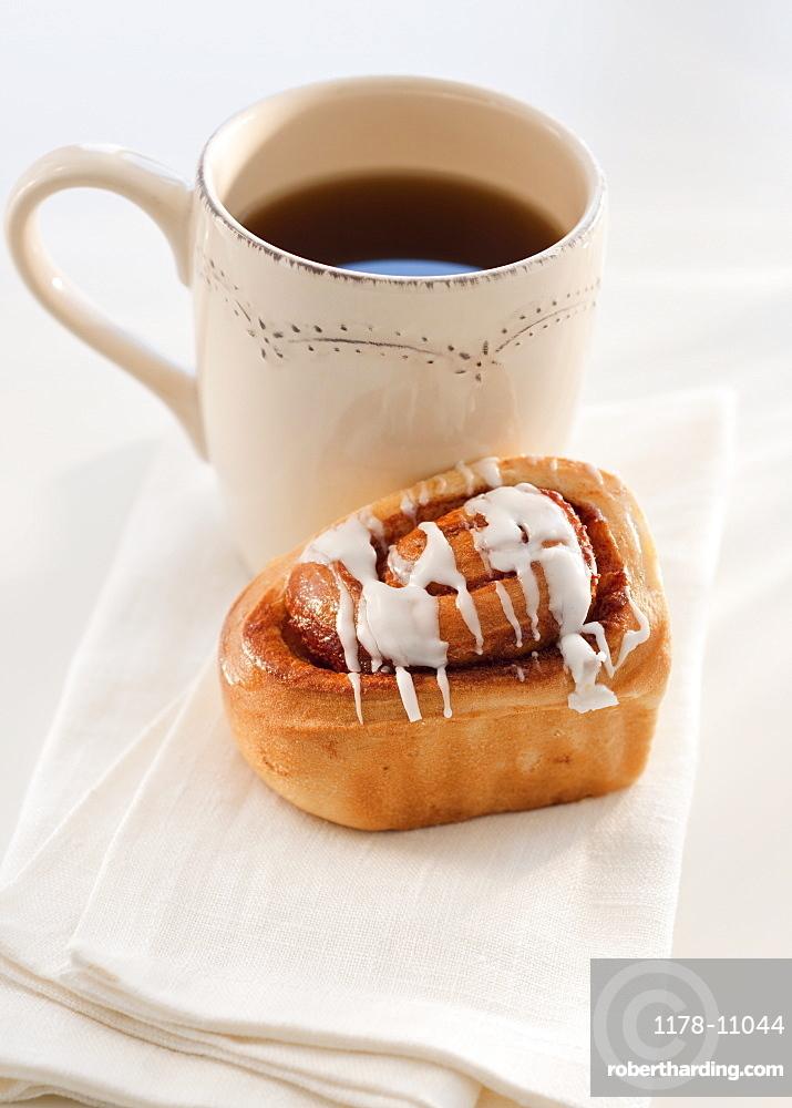 cinnamon bun with coffee