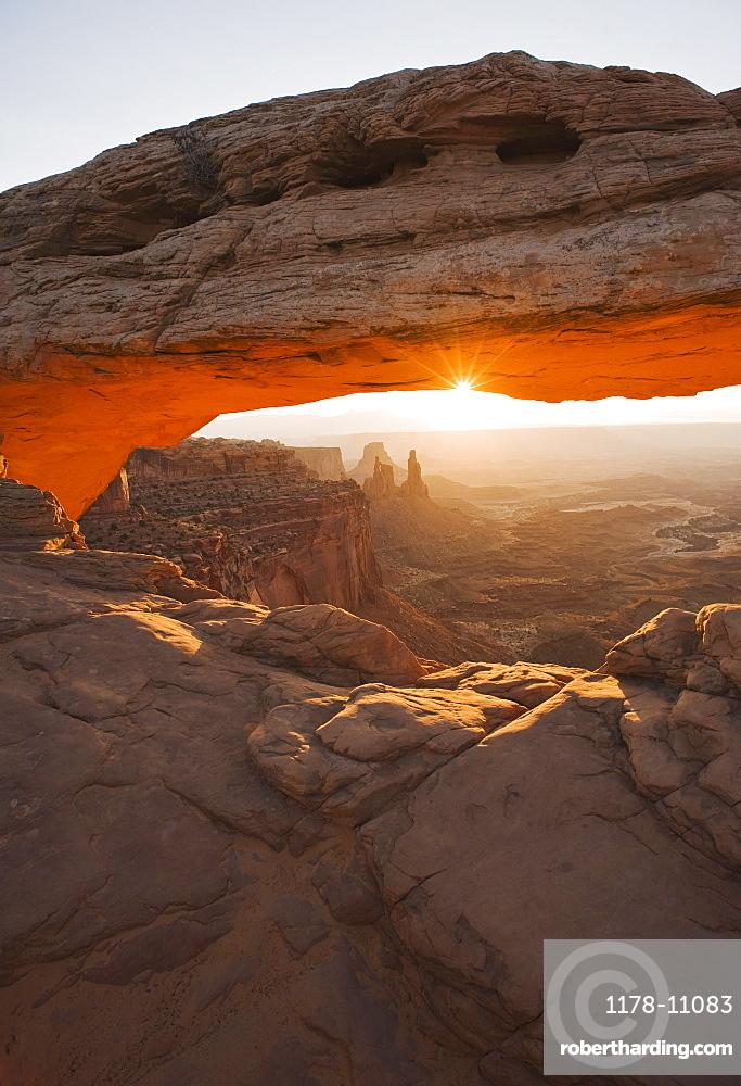 Sun shining behind Mesa Arch, Canyonlands National Park, Utah