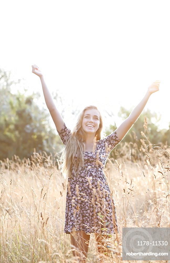 Outdoor portrait of happy teenage girl (16-17)