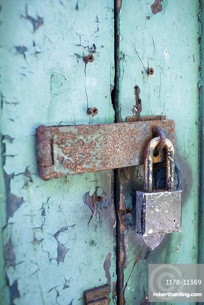 Old rusty padlock on door