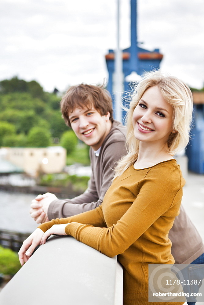 Portrait of young couple on bridge