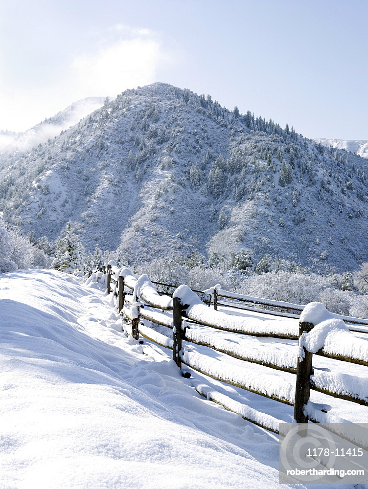 USA, Colorado, snowy ranch with pen