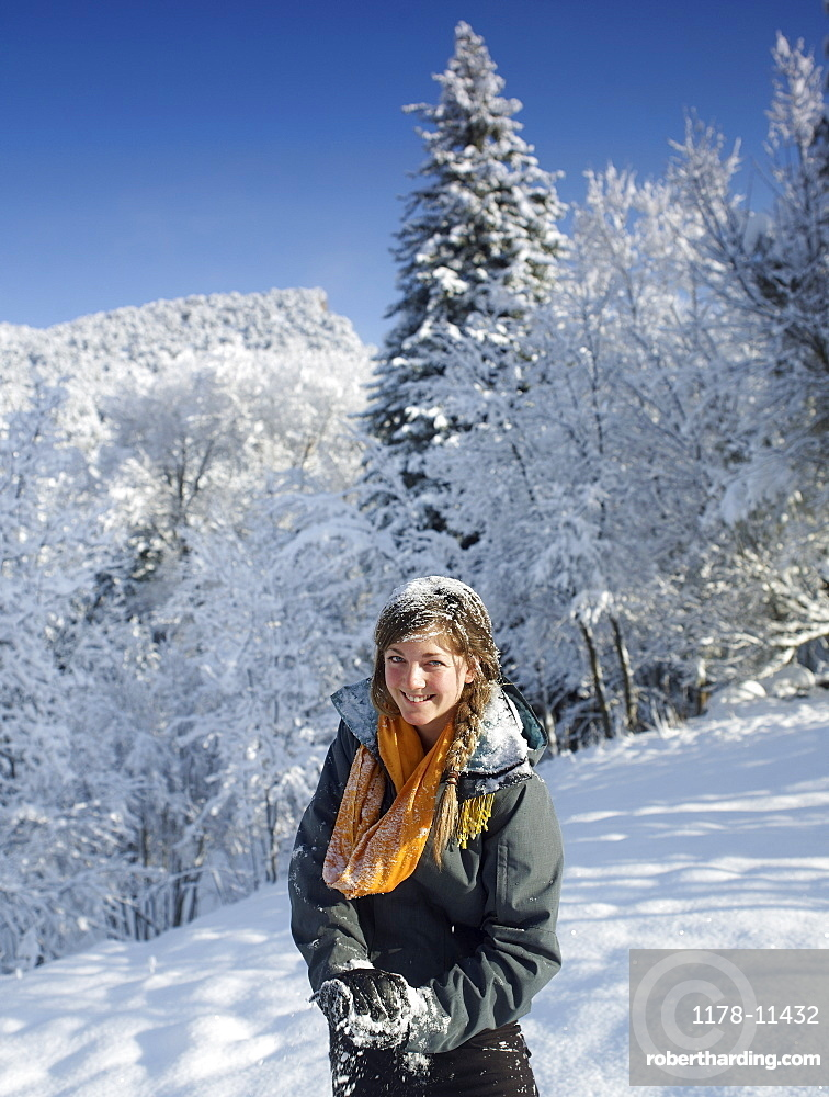 USA, Colorado, portrait of young woman in winter landscape