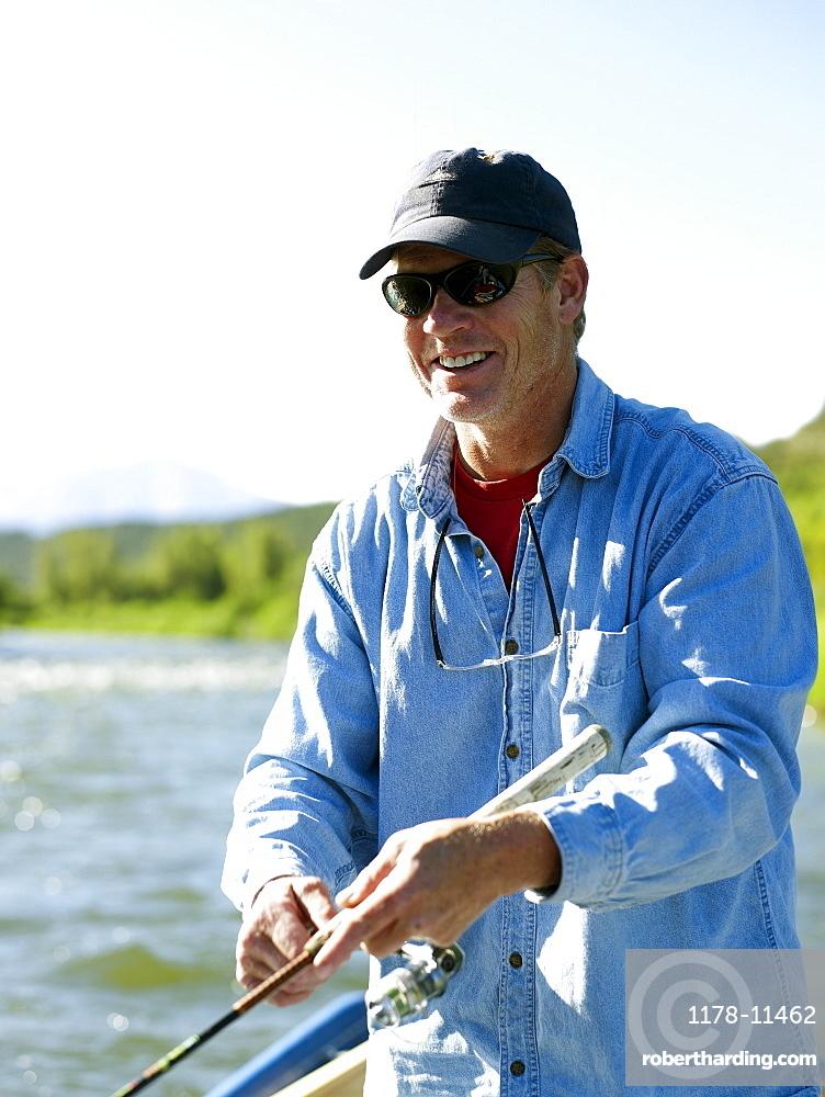 USA, Colorado, Mature man fly-fishing