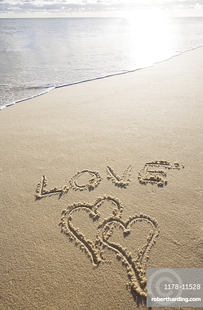 USA, Massachusetts, love sign with heart shapes on sand