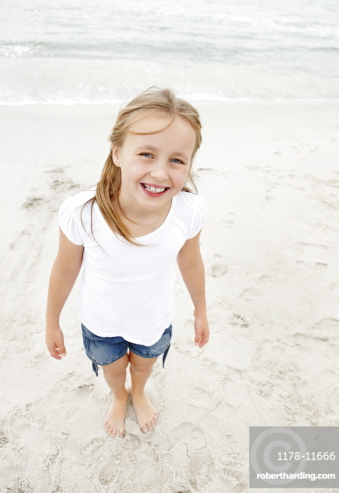 Portrait of smiling girl (10-11) at beach