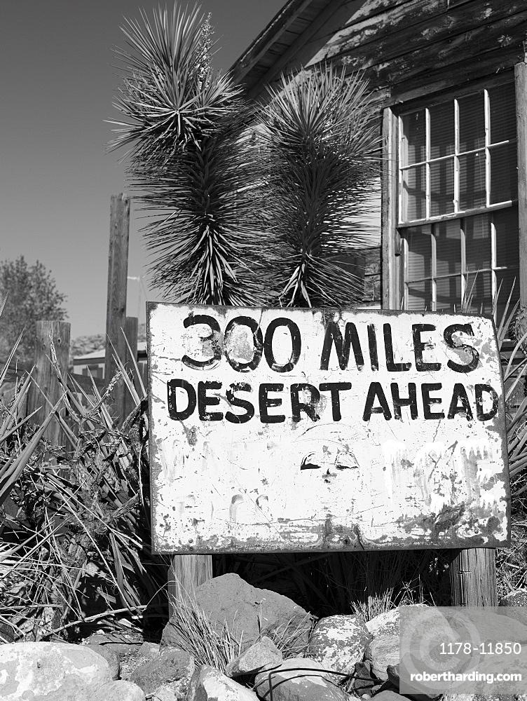 Road sign in the desert