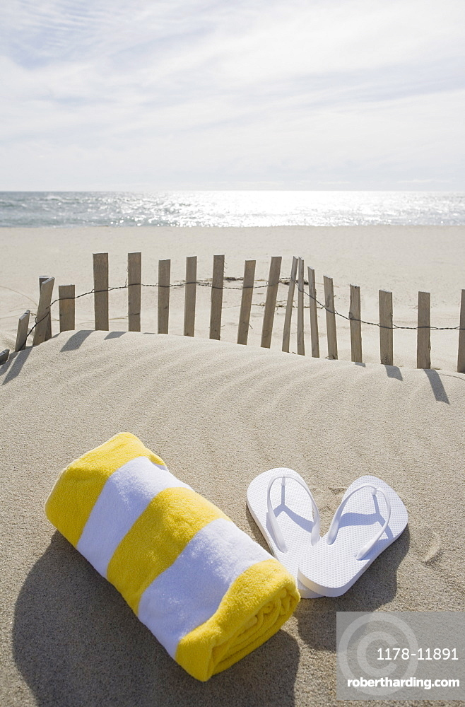 Towel and flip flops on the beach