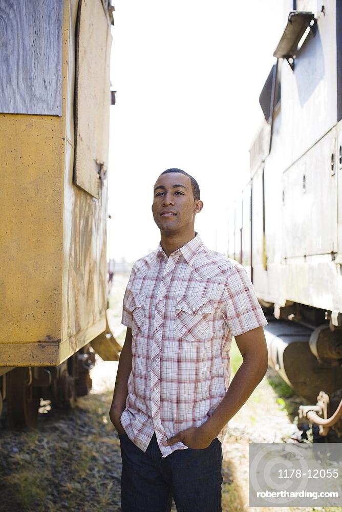 Young man beside train