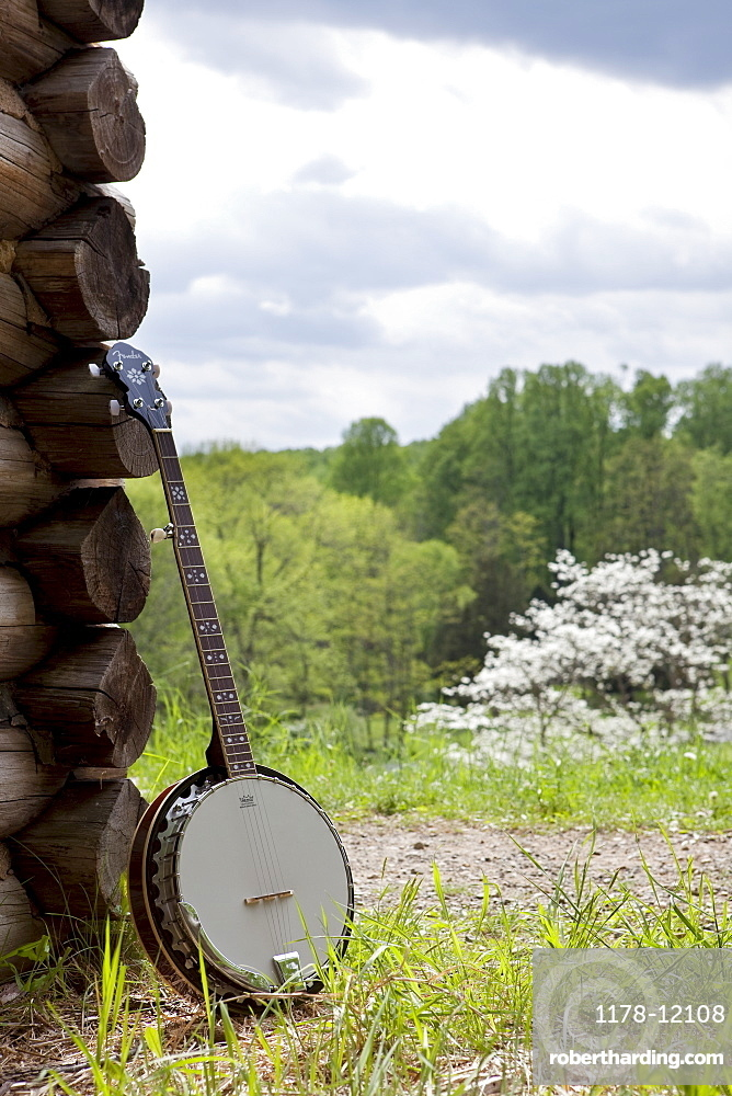A banjo leaning against the wall of a cabin