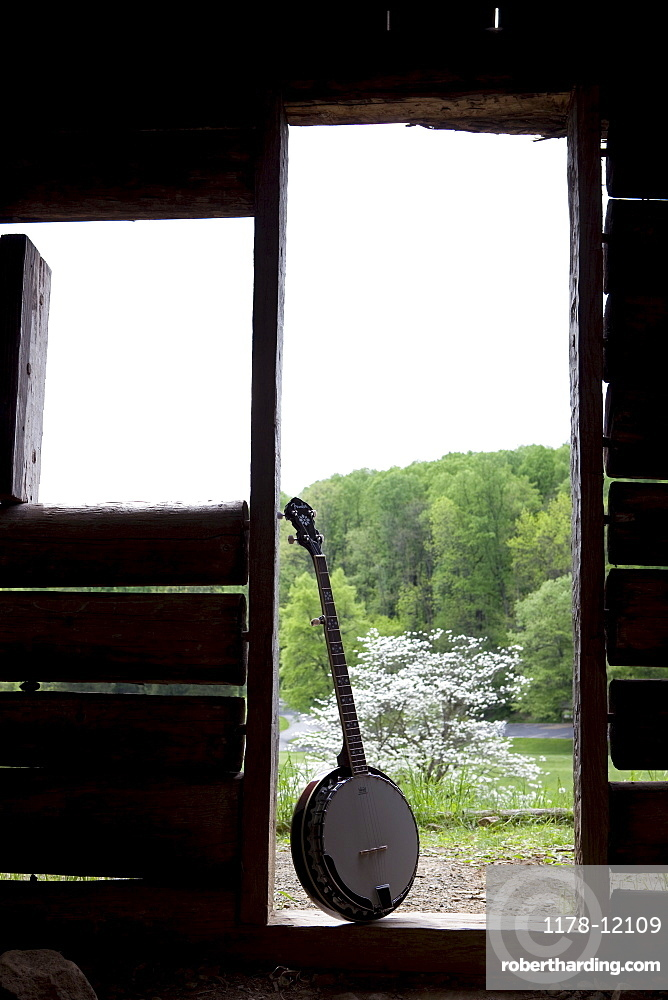 A banjo in the doorway of a cabin