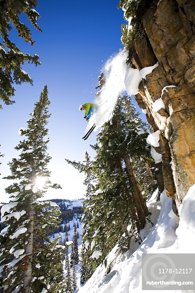 Skier jumping off cliff Aspen Snowmass, Aspen, Colorado, USA
