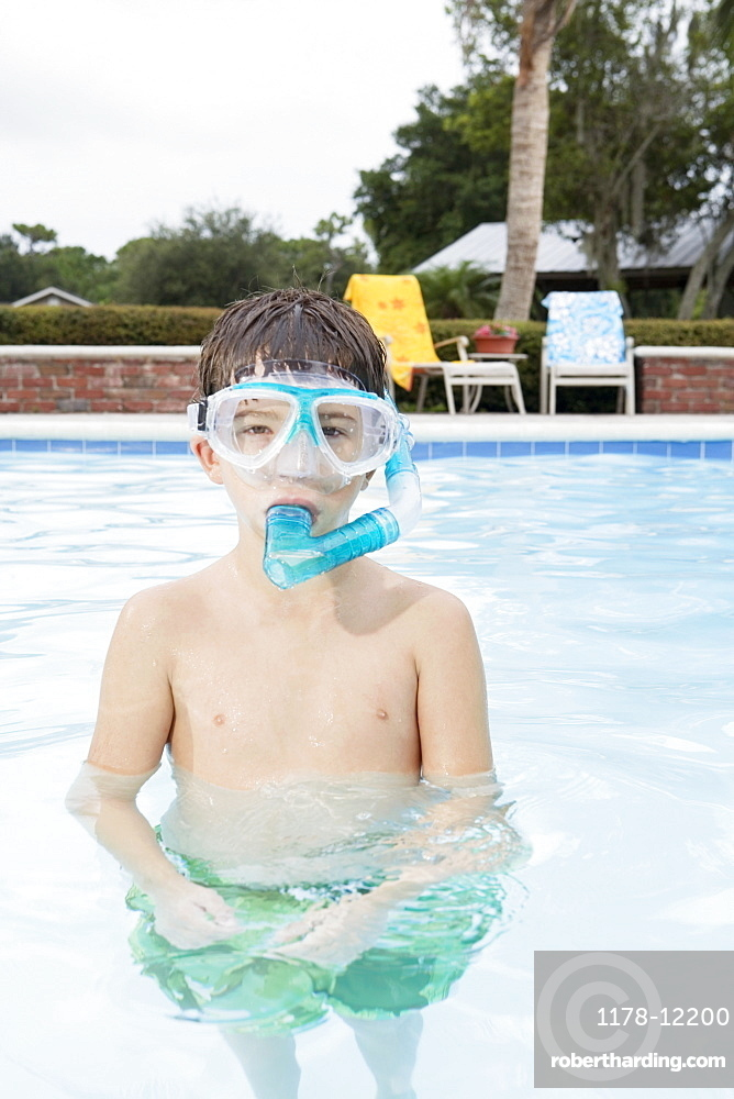 Boy snorkeling in swimming pool