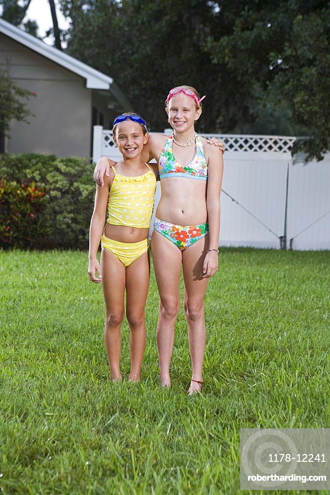 Girls posing on lawn