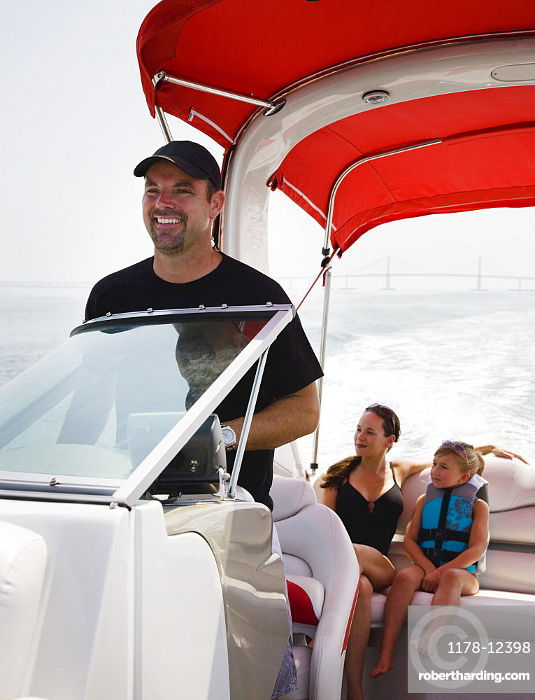 Family relaxing on boat, Florida, United States