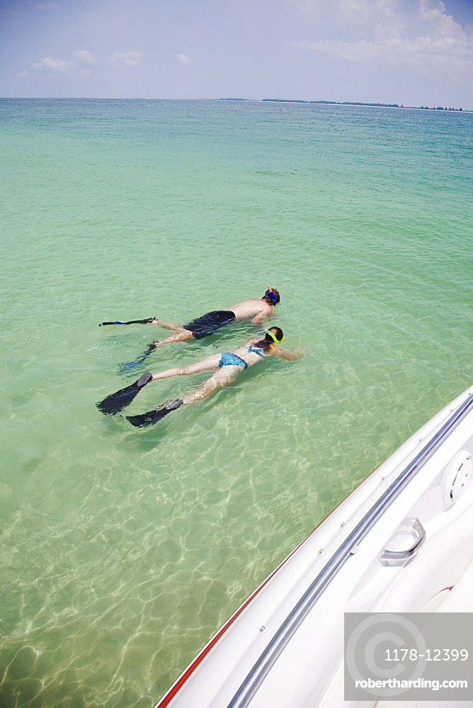 People snorkeling in water, Florida, United States
