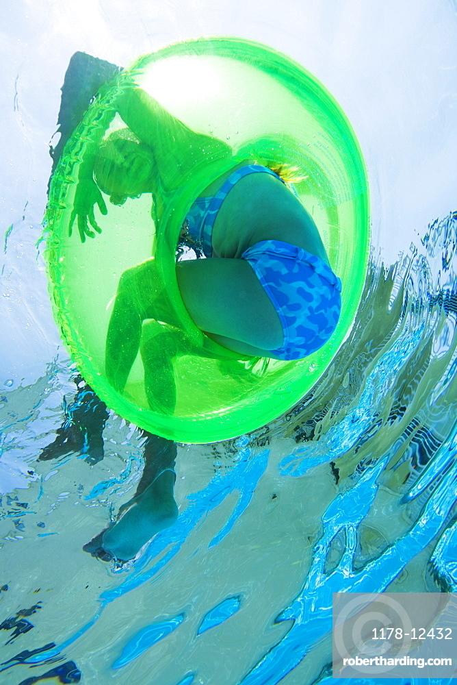 Underwater shot of child in inner tube, Florida, United States