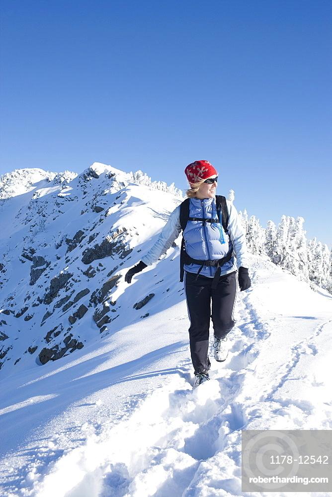 Woman hiking  in winter scenery