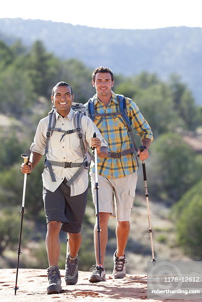 USA, Arizona, Sedona, Young men hiking in desert