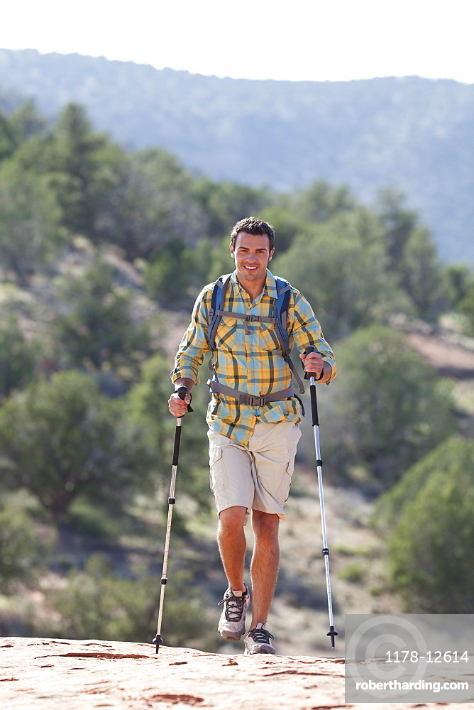 USA, Arizona, Sedona, Young man hiking in desert