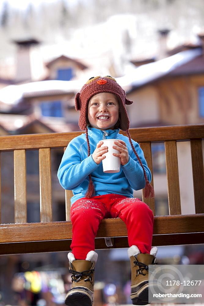 USA, Colorado, Telluride, Boy (4-5) enjoying hot chocolate