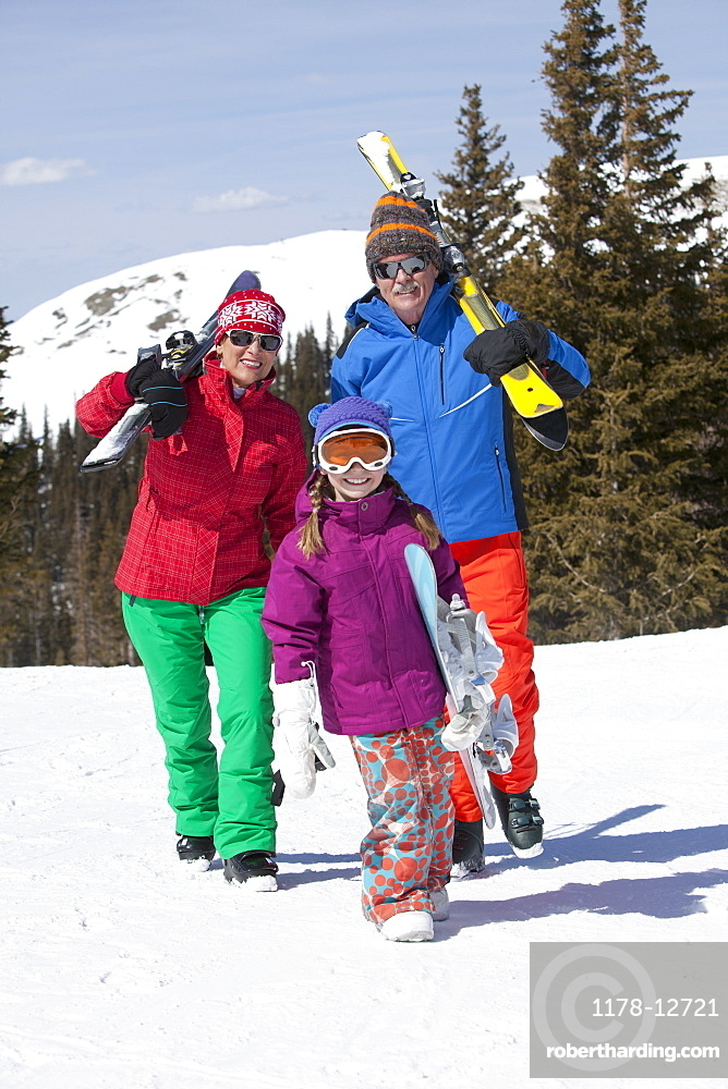 USA, Colorado, Telluride, Grandparents with girl (10-11) posing during ski holiday