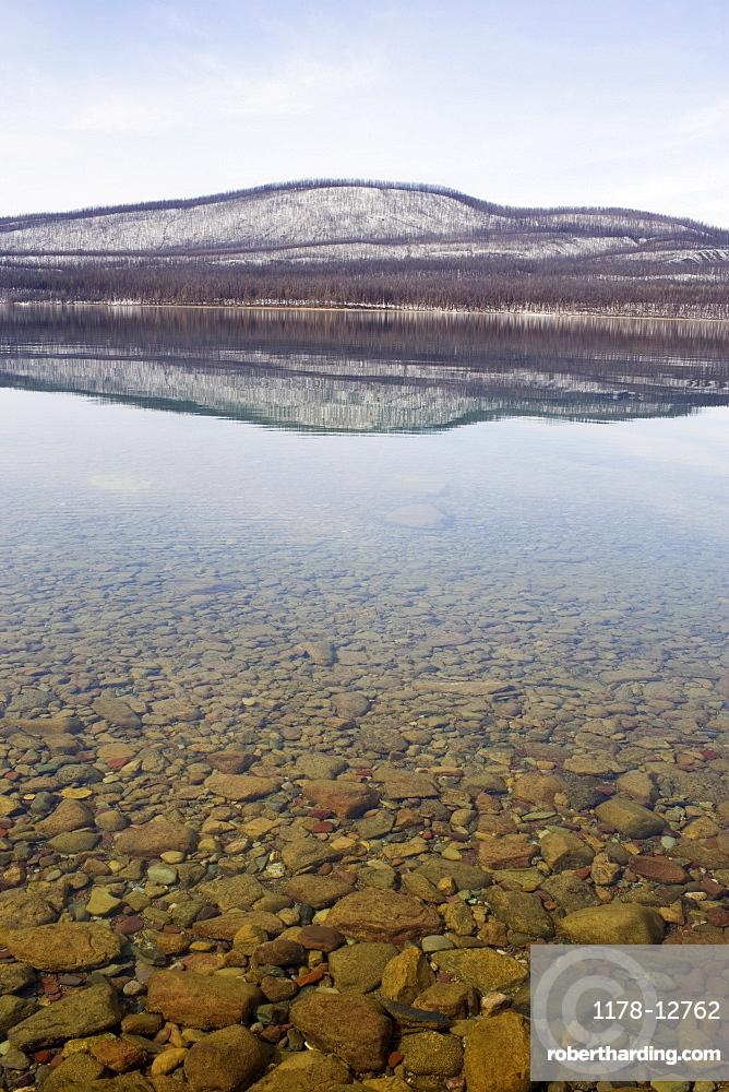 USA, Colorado, Hills reflected in lake