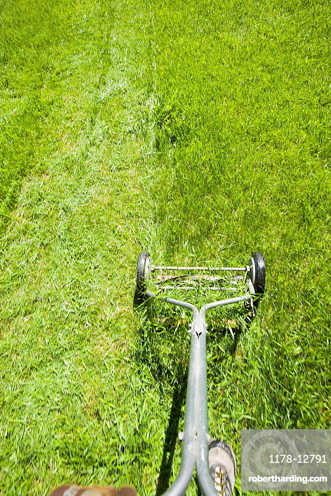 USA, California, Point Reyes, Old fashioned mower on lawn