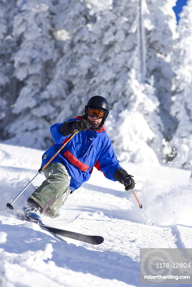 USA, Montana, Whitefish, Male skier on mountain slope