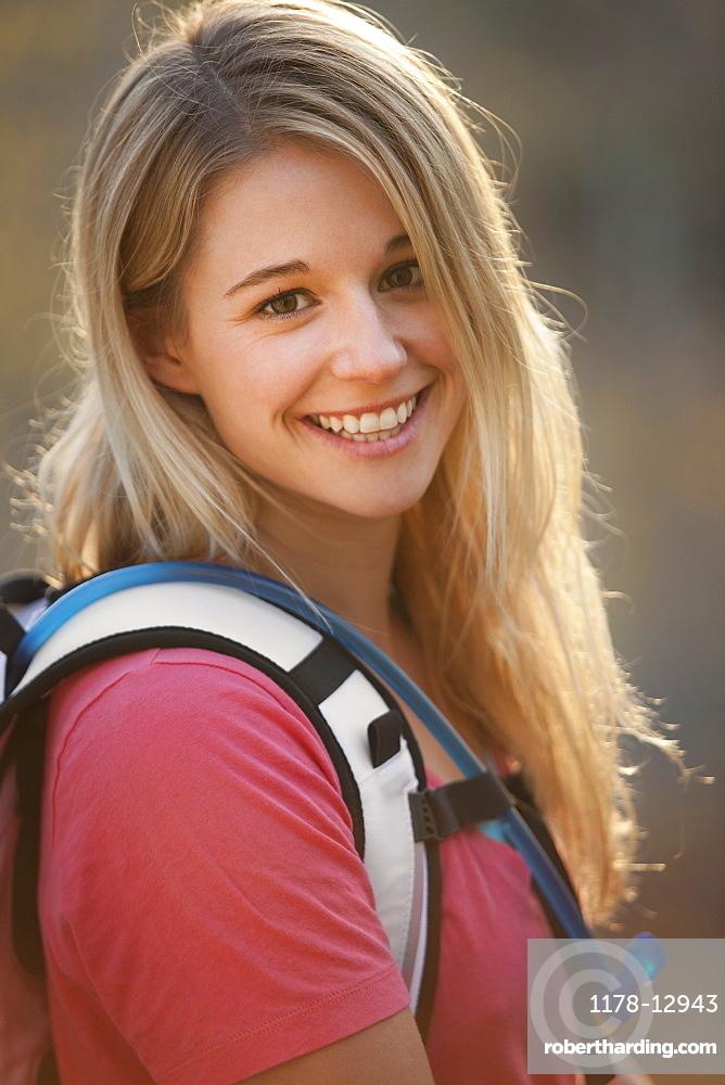 USA, Utah, portrait of young hiking woman