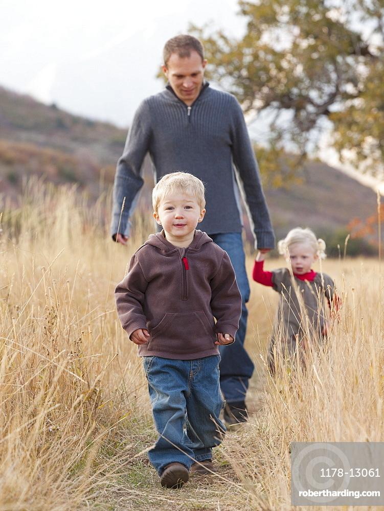 Family walking in a meadow